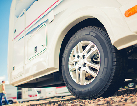 close up of motorhome tyres parked on a holiday site