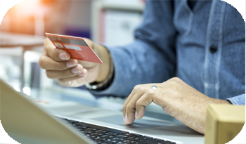 An individual comparing credit cards online | Compare the Market