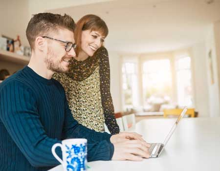 couple looking a laptop