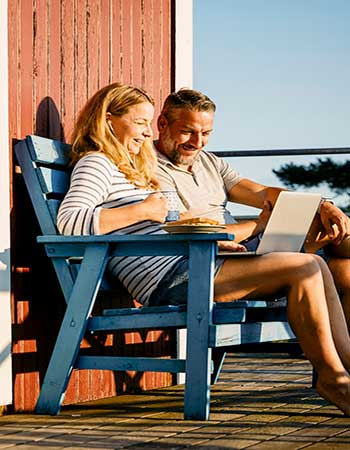 Couple looking at what they need to get a quote for their holiday home.