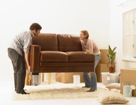 Couple lifting sofa