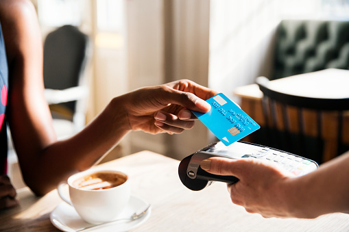 A woman paying by credit card