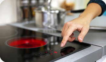 An individual using an electric or induction hobs | Compare the Market