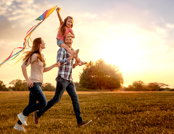 Family running with kite