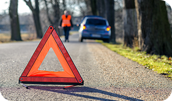 An image of a hazard cone behind a car | Compare the Market