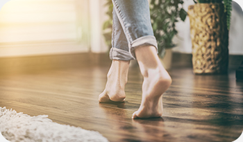 an individual walking on wooden floor | Compare the Market
