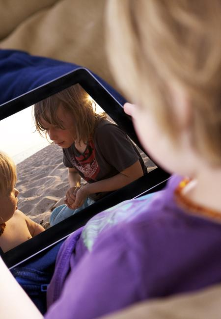 A child watching a film on their iPad