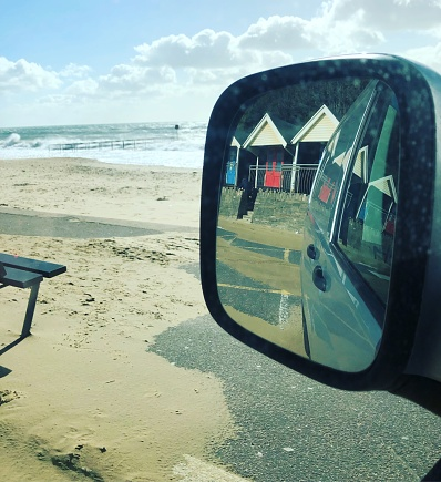 Van mirror on a beach