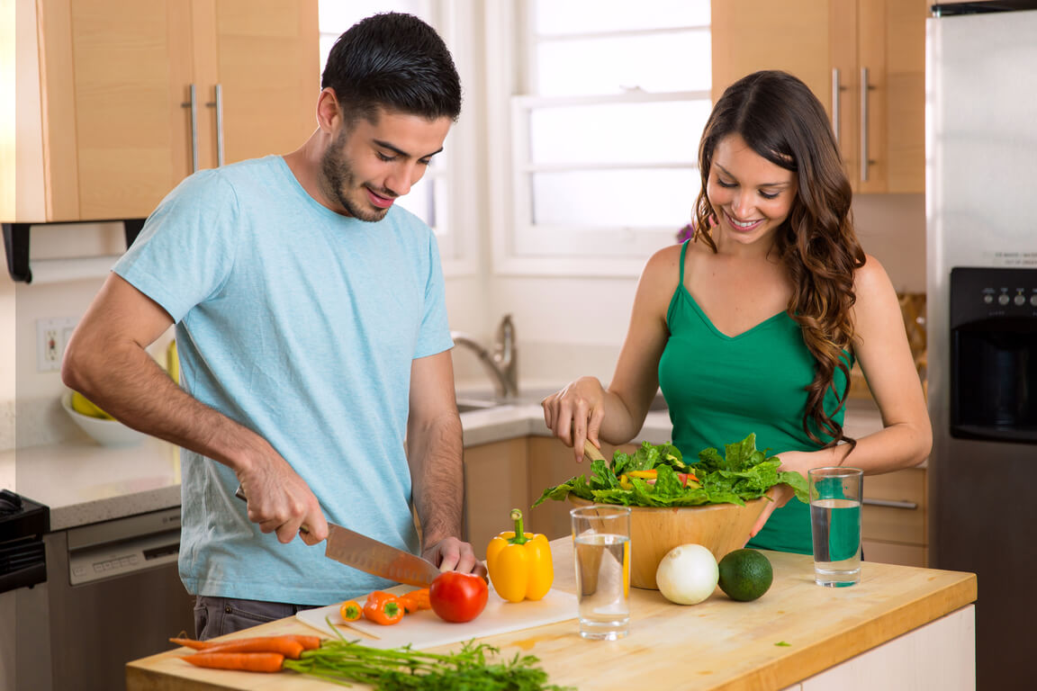 Couple learning to cook