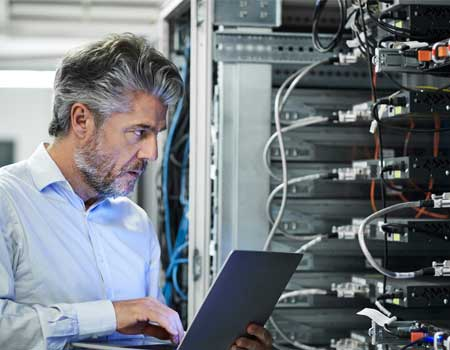 Man in an I.T server room