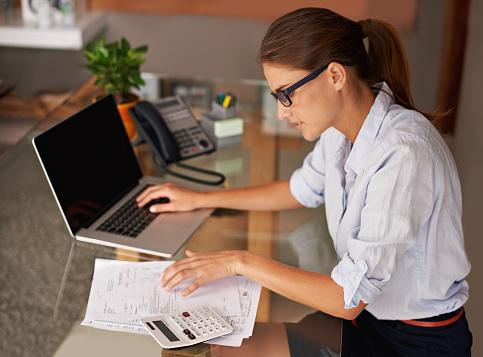 Lady on laptop searching for current accounts