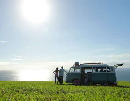 Couple outside motorhome in the countryside