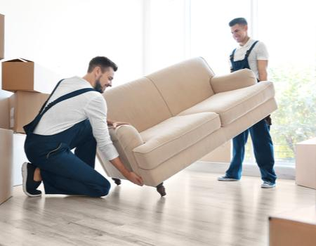 Men moving furniture in home