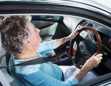 Old lady driving without glasses