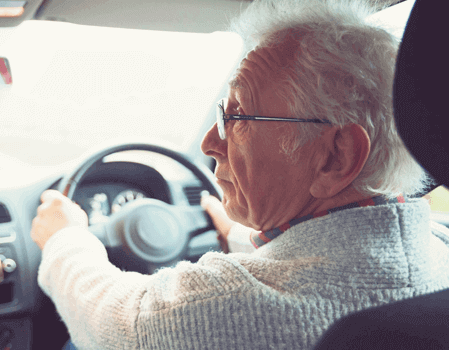 An old man driving his car.