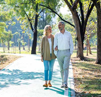 An over 50s couple taking a walk together in a park