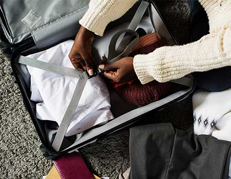 Person packing suitcase