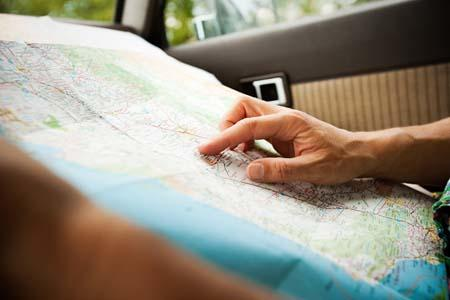 An individual looking at their journey abroad on a map