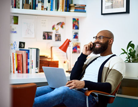 A self-employed man on the phone in his office