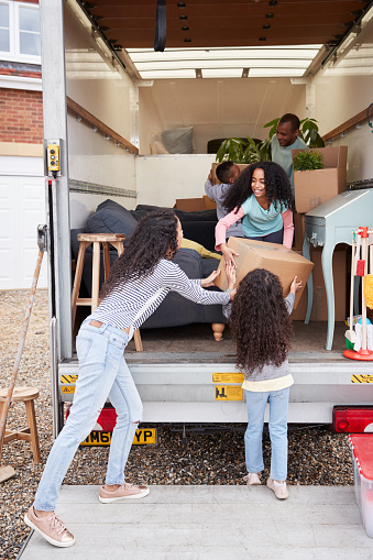 Family taking items out of van