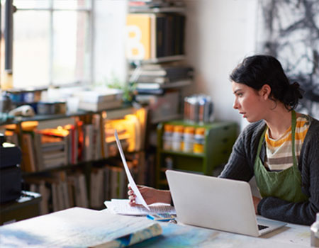 Women looking at tax return paper in her workspace