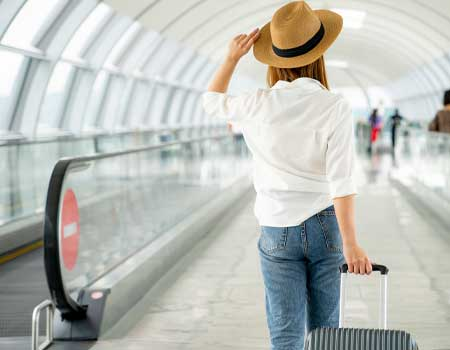 traveler with suitcase at airport