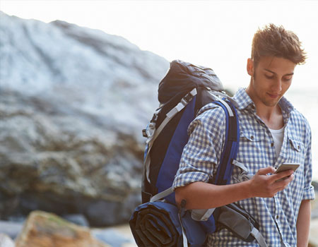 Man using his mobile data whilst hiking