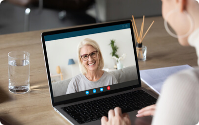 An individual using Skype, which works faster since they have upgraded their broadband.