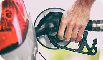 An individual putting diesel into their car | Compare the Market